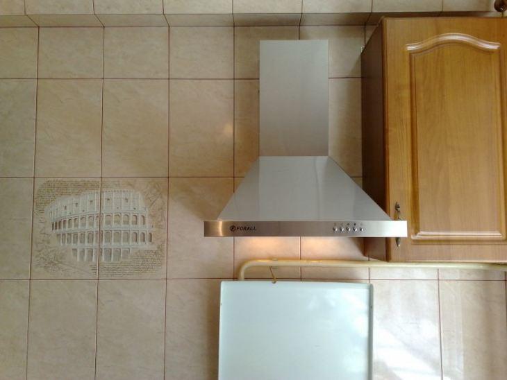 Вытяжка в форме трубы для кухни